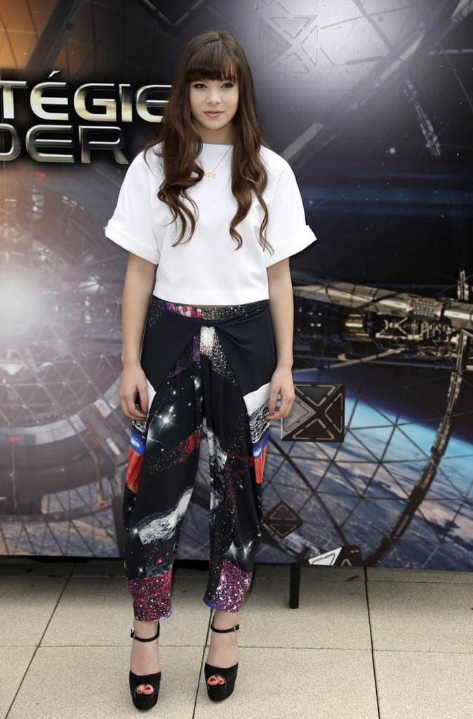 It wasn't a dress day for Hailee Steinfeld, who picked graphic Clover Canyon pants and a boxy white wool top from Osman by Osman Yousefzada to promote Ender's Game in Paris. The bold bottoms necessitated a simple shoe, which she got via Brian Atwood's satin platforms.