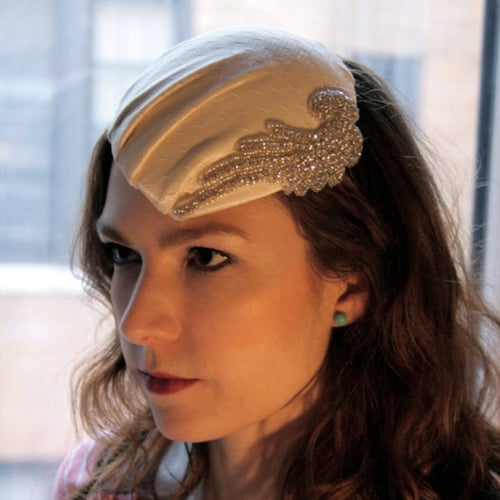 Vintage-Inspired Cream Lace Hat With Beaded Angel Wing ($65)
