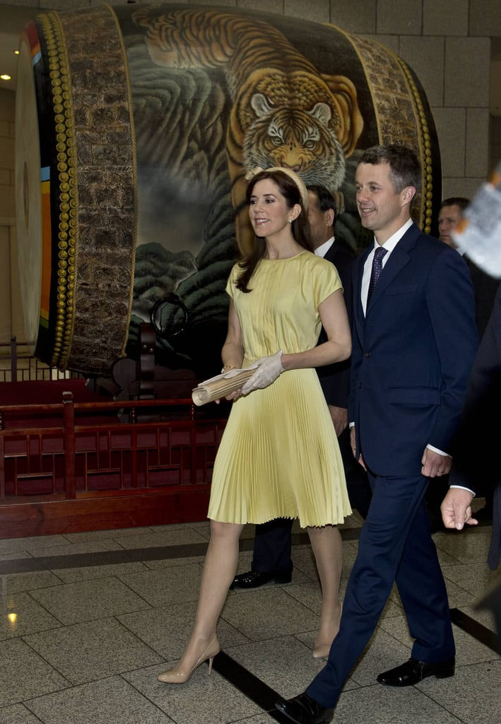 This pleated daffodil frock is our favourite look from Mary's tour of South Korea. The sorbet yellow hue combined with the sunray skirt and dainty accessories a perfect example of how to work the ladylike look, without resorting to frou-frou details.