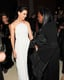 Katie Holmes looked angelic as she chatted inside the Met Gala with makeup artist Pat McGrath. Source: Billy Farrell/BFANYC.com