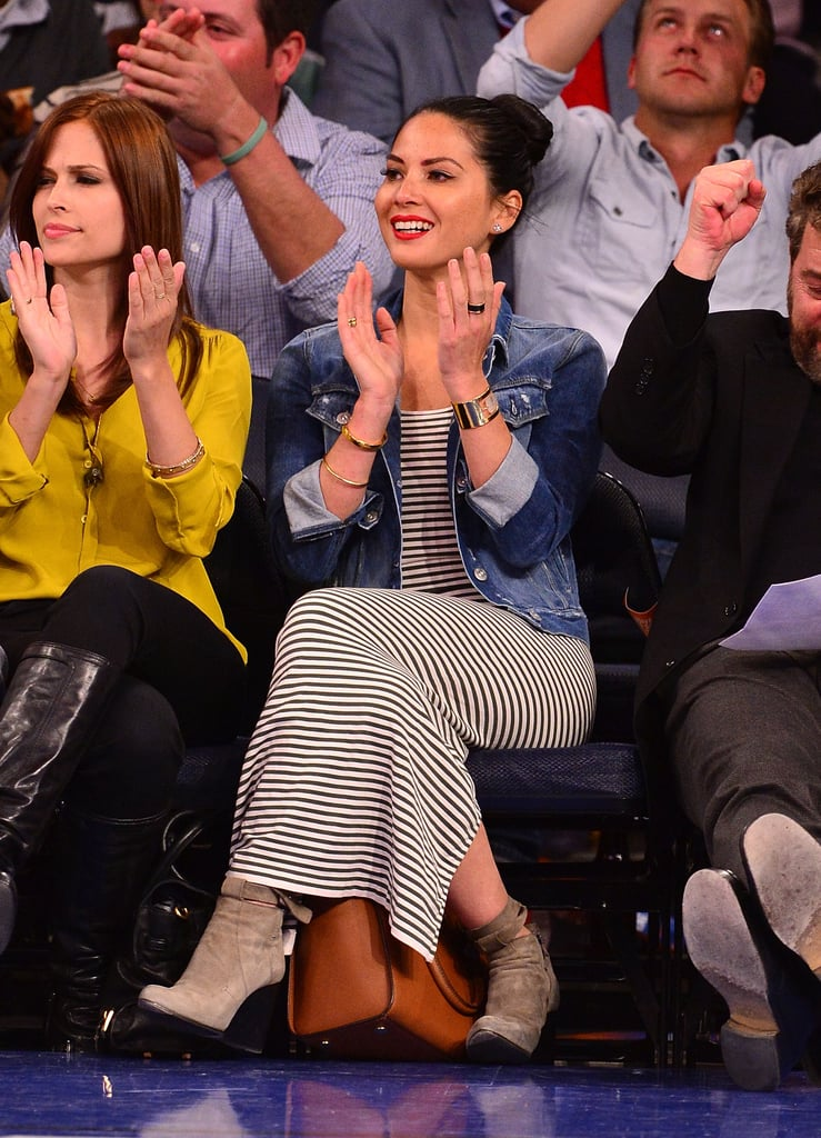 Olivia Munn was spotted courtside at Madison Square Garden in a striped maxi and denim jacket. She accessorized her outfit with a pair of suede ankle booties and a Kelly Wearstler cuff.