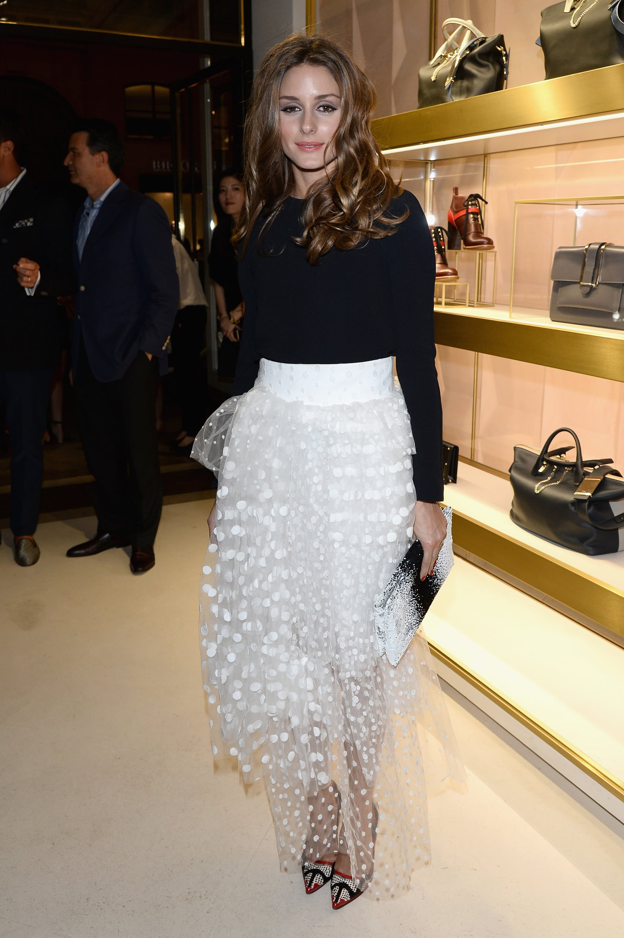 We have a feeling that Carrie Bradshaw would approve of Olivia's tutu-inspired dress.