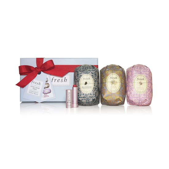 When in doubt, you can't go wrong presenting the Fresh Oval Soap Trio and Lip Sugar Gift Set ($45) to your hostess. Not only are the soaps a sight to behold, but also, the lip balm is a cult classic.