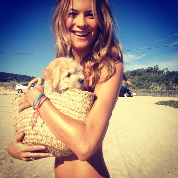 Behati Prinsloo posed with a puppy on the set of a Victoria's Secret shoot in St.-Tropez. Source: Instagram user behatiiprinsloo