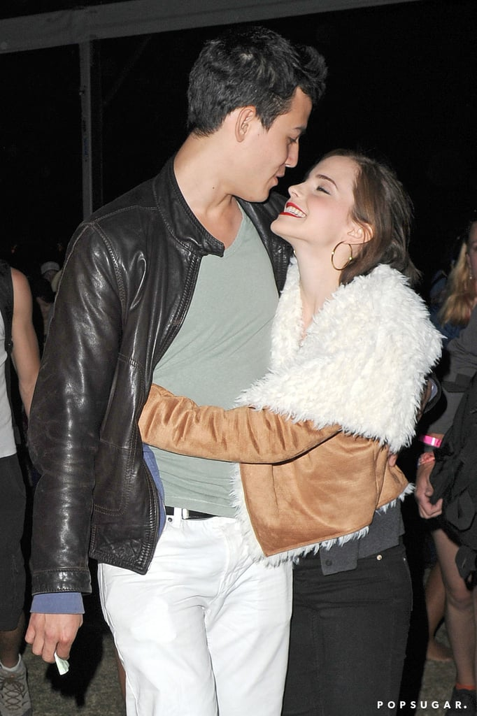 Emma Watson and her man cuddled up during a show in 2012.