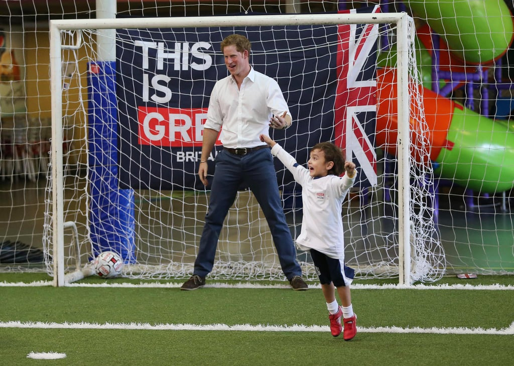 Prince Harry played soccer with a young boy during his tour of Brazil on Tuesday.