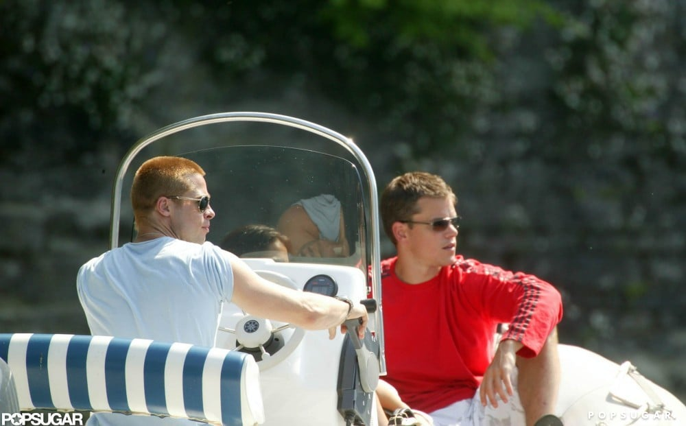 Matt Damon and Brad Pitt hung out on a boat on Lake Como while vacationing with family and friends in June 2004.