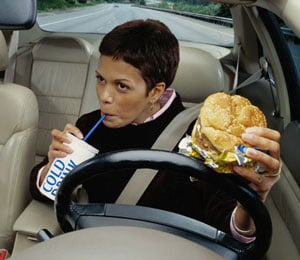 Avoid These 10 Foods While Driving to Keep Insurance Costs Down