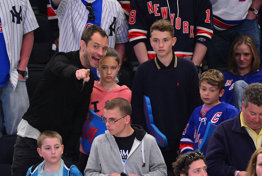 Jude Law toted his kids Iris, Finlay, and Rudy to a New York Rangers game together in NYC in April 2012.