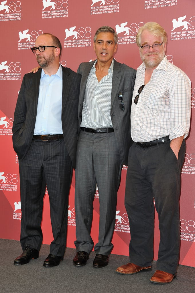 Paul Giamatti, George Clooney, and Philip Seymour Hoffman pose together.