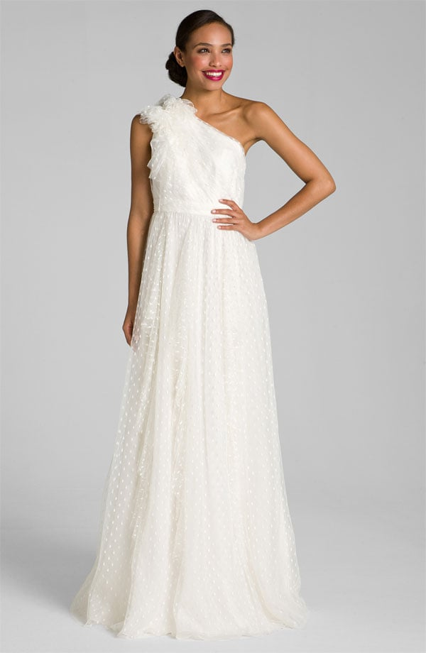 One-shouldered wedding gowns are so unique and this Carmen Marc Valvo dotted tulle one-shoulder gown ($1,080) has adorable dots that make it even more lovable.