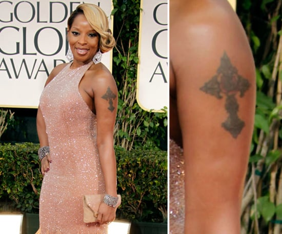 Mary J. Blige belts out big hits, and when it comes to tattoos she goes big. Mary has a large cross on her left arm and her name on her right.