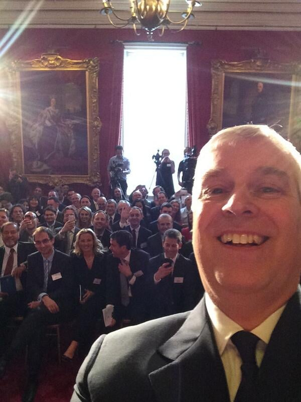 Prince Andrew took the first-ever royal selfie in April 2014 during a press conference in London. Source: Twitter user TheDukeOfYork