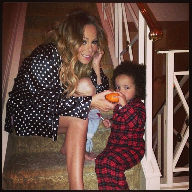 """Mariah Carey shared a photo with her son, Moroccan, while getting prepped for Halloween with the caption, """"Roc's first pumpkin!!!"""" Source: Instagram user mariahcarey"""