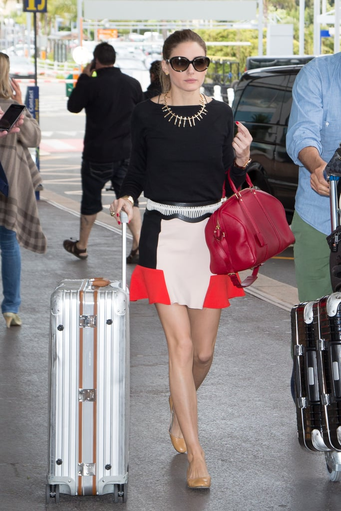 Olivia Palermo proved that heading to the airport is no reason to sacrifice style. The fashion pro brought the colour-blocking trend to the jetway with a Zara skirt, finishing it off with a statement necklace and sensible flats.