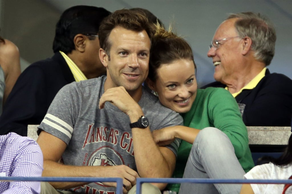Olivia Wilde and Jason Sudeikis cuddled while checking out matches during the US Open in August 2013.