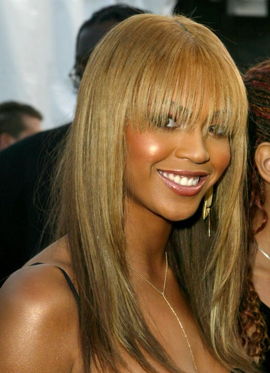 At the 2003 American Music Awards, Beyoncé hid behind eye-grazing bangs. Her sun-kissed cheeks and coordinating lip gloss complemented her fringe beautifully.
