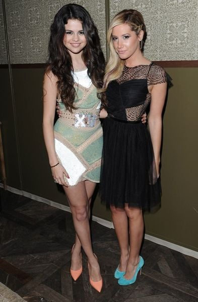 At Nylon's February 2013 launch party in LA, Ashley Tisdale — pictured here with Selena Gomez in Atelier Versace — sported this Asos cobweb lace dress ($50, originally $71) with blue suede Christian Louboutin pumps.