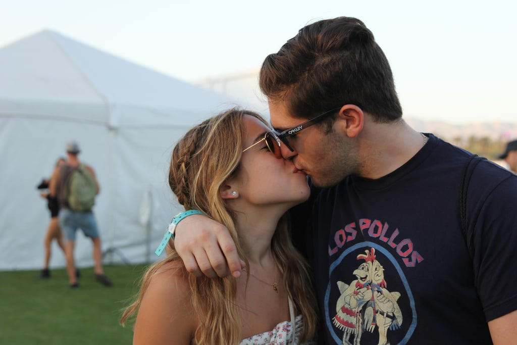 A pair locked lips at 2015's Coachella Music Festival.