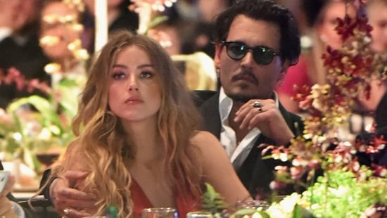 Amber Heard Seeks a Restraining Order Against Johnny Depp Just Days After Their Divorce Was Announced