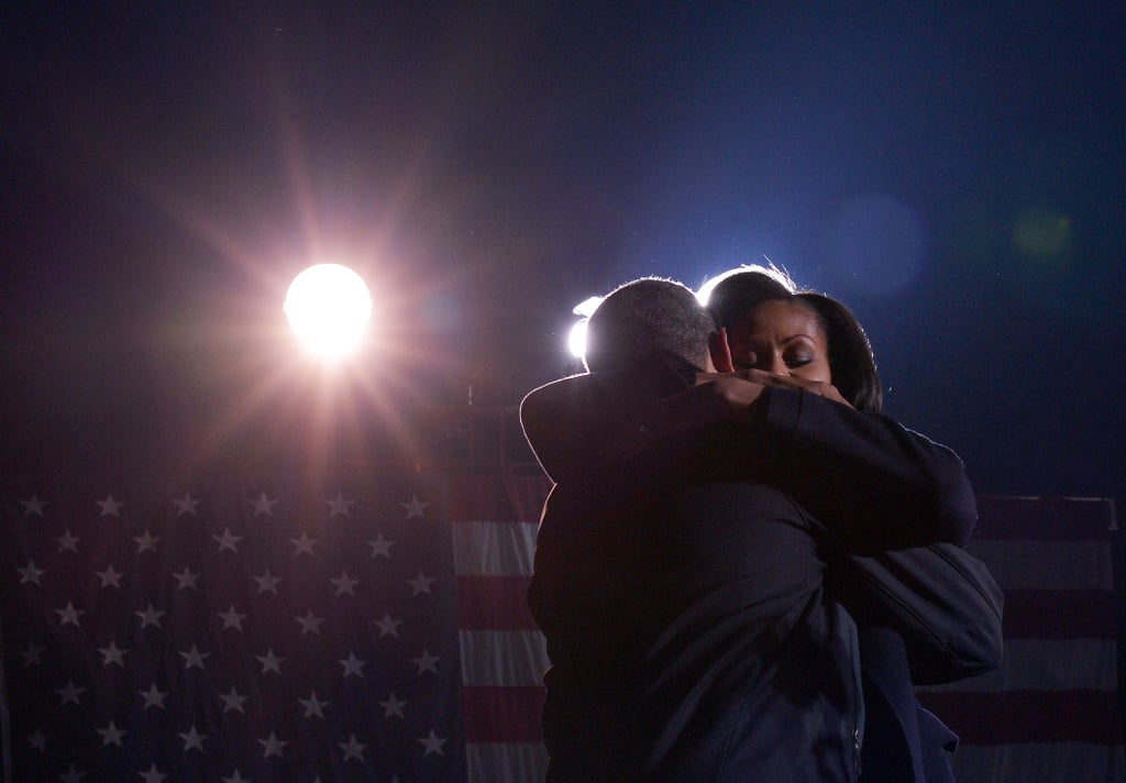 The Obamas held on to each other at a Des Moines campaign event.