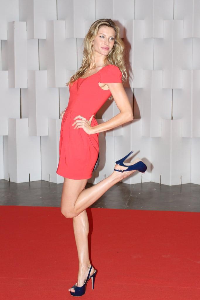 Gisele Bundchen Kicks Up Her Heels in a Hot Red Dress