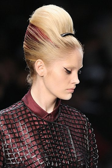 """Makeup: YSL did """"Fellini eyes"""" but it wasn't the only time we saw dramatic liner on catwalk lids."""
