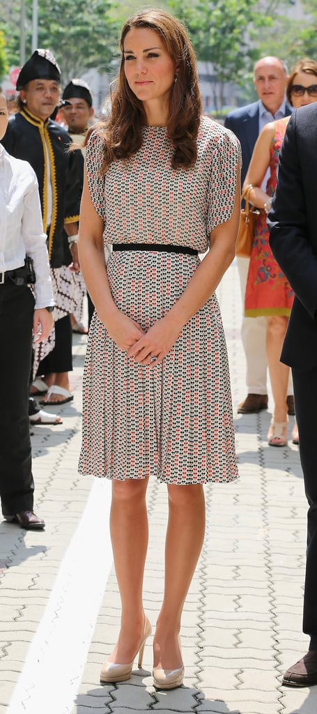 Kate Middleton chose a sweetly printed Raoul blouse and skirt combo for day two of seeing the Singapore sights. To go with, she paired her trusty nude L.K. Bennett pumps with the look.