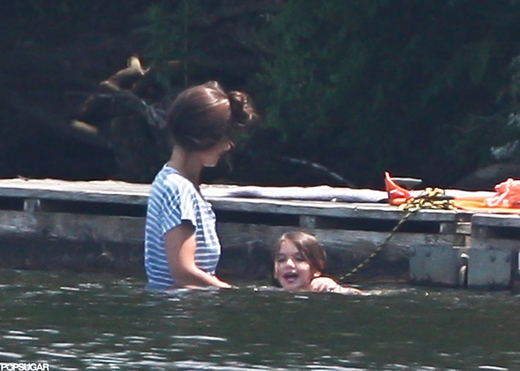 Katie Holmes helped Suri Cruise into the water while visiting a pond in Kent, CT.