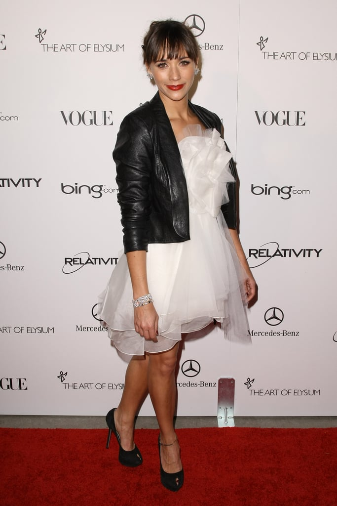 Rashida Jones in a frothy white dress and tough leather jacket.