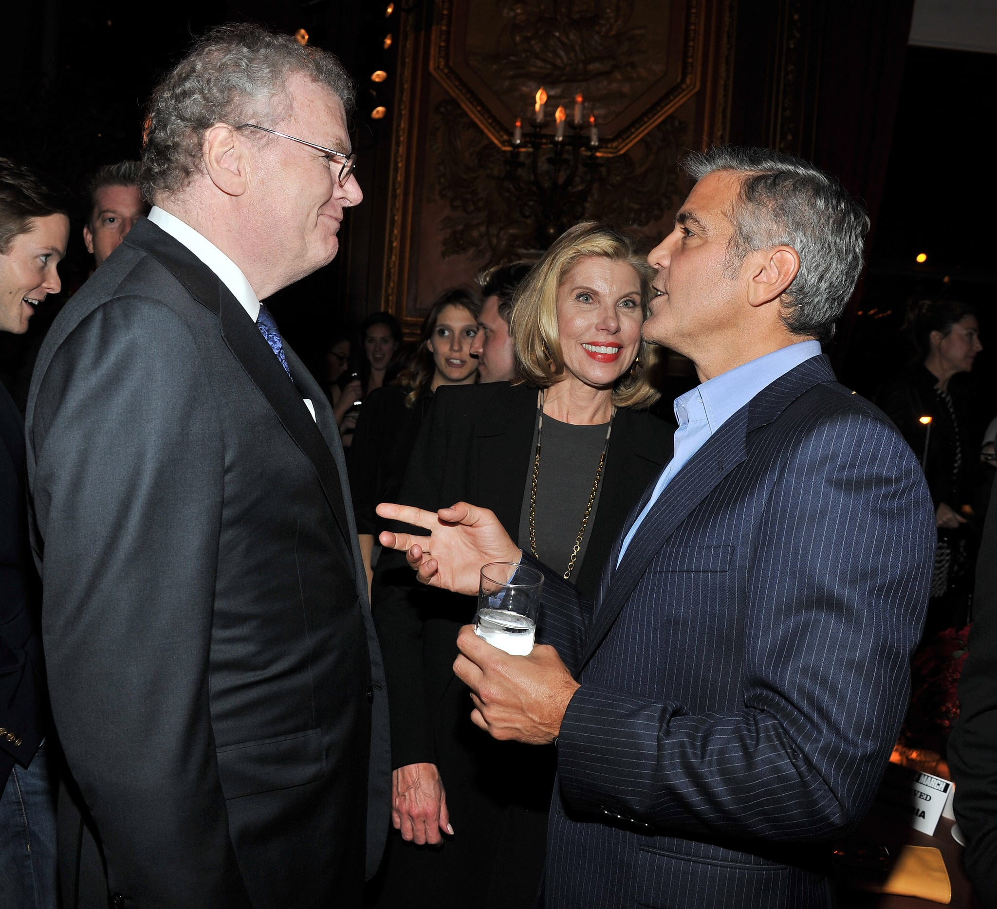 Sony Corporation chairman, president, and CEO Sir Howard Stringer, Christine Baranski, and George Clooney chat at the afterparty for the premiere of The Ides of March.
