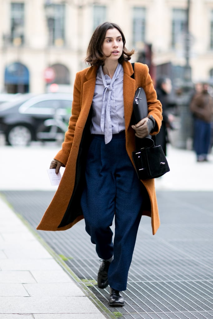 Bringing '70s chic to 2014 with a tie-neck blouse and trousers.