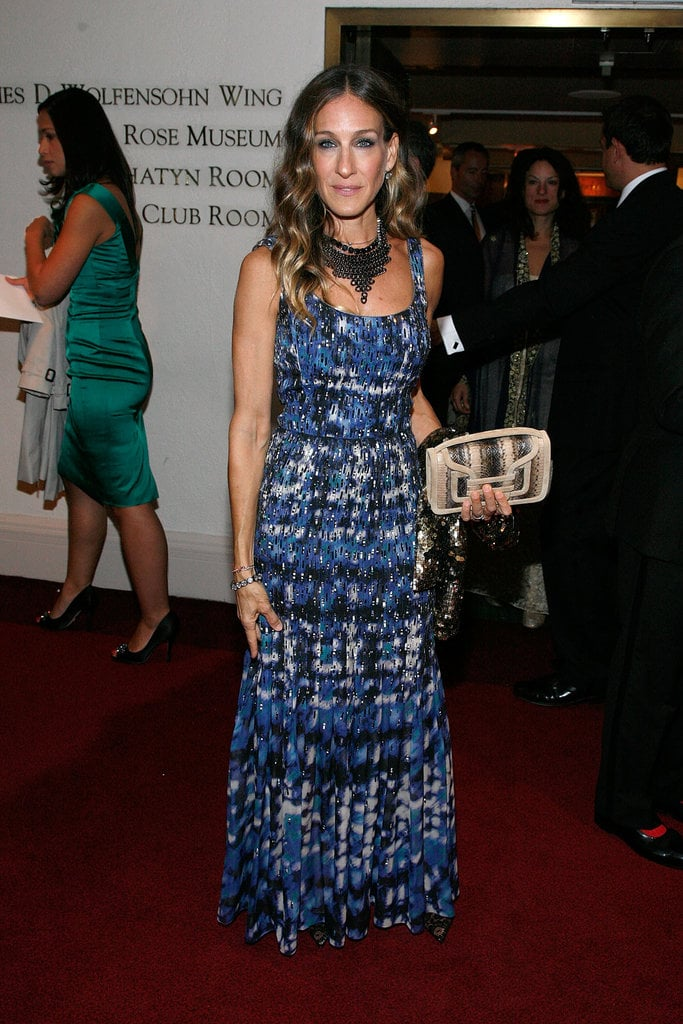 Sarah Jessica Parker mingled at Carnegie Hall in NYC in a printed Oscar de la Renta gown, which she topped off with statement jewels and a snakeskin Pierre Hardy clutch in hand.