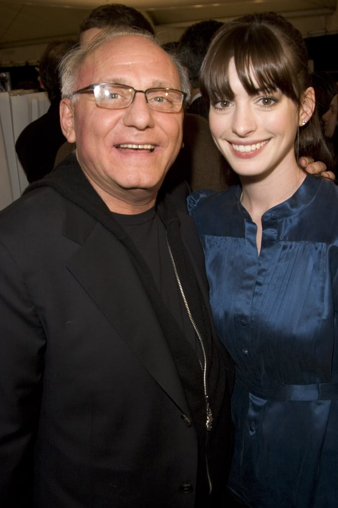 Anne Hathaway posed with designer Max Azria backstage in September 2006.