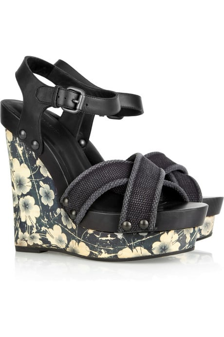 The pretty printed wedge on these wood-heeled sandals feels almost like a piece of art, but maintains a totally wearable vibe.  Bottega Veneta Printed Wooden Wedge Sandals ($820)