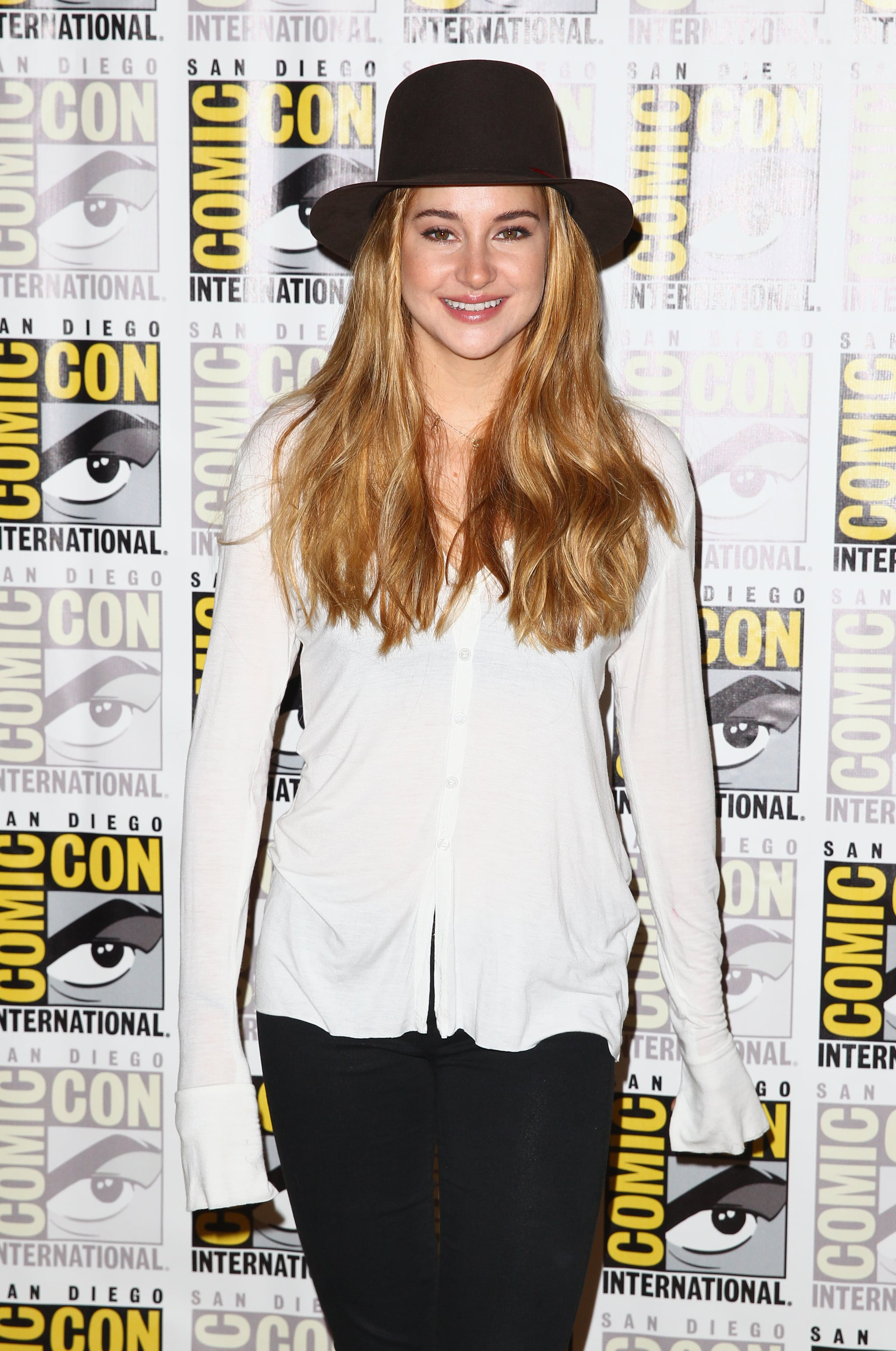 Shailene Woodley tucked her blond locks under a fun wide-brim hat for the press line for Divergent.