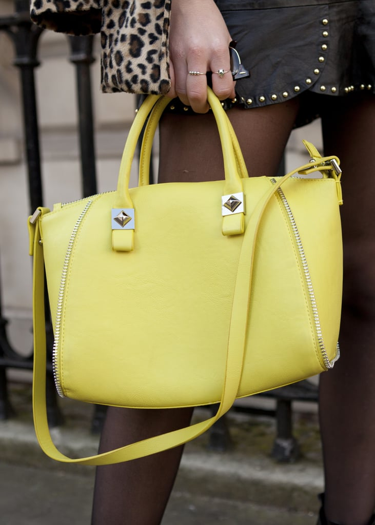 A bright yellow satchel added a cheery pop of color to this LFW look.