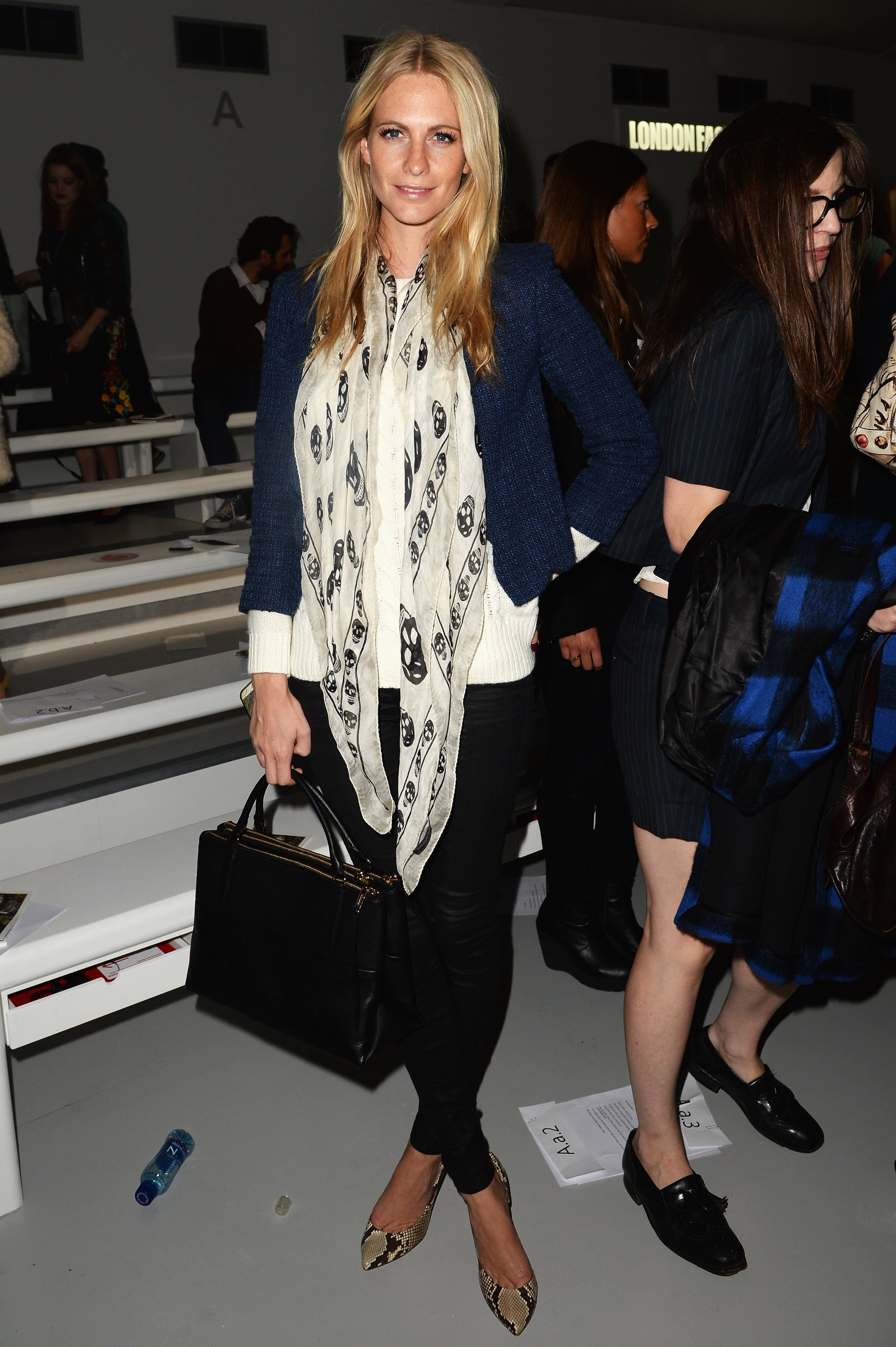 Poppy Delevingne accessorized with an outfit-making scarf while at Simone Rocha's runway show.