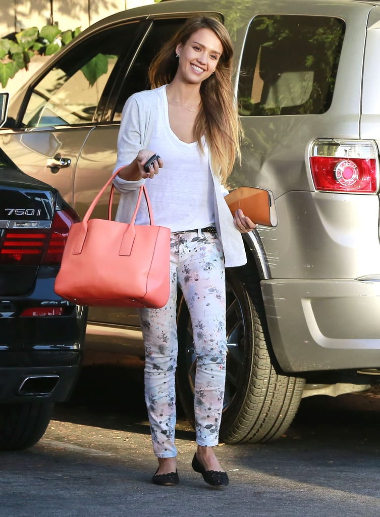 Jessica tucked a white tee into floral denim, then spiced things up with a coral bag in West Hollywood.