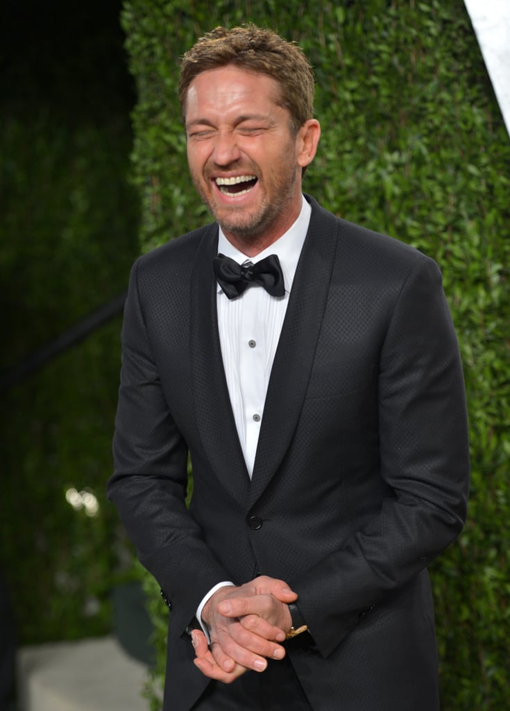 Gerard Butler laughed as he arrived at the Vanity Fair Oscar party on Sunday night.