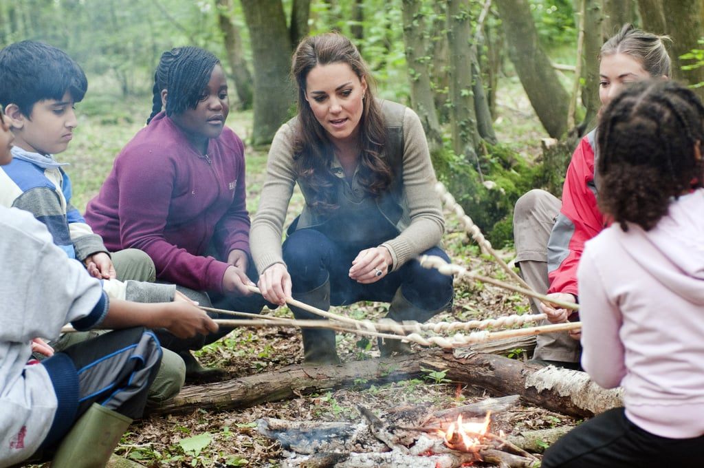 Kate Middleton roasted food on the fire with children from Expanding Horizons primary school outdoor camp.