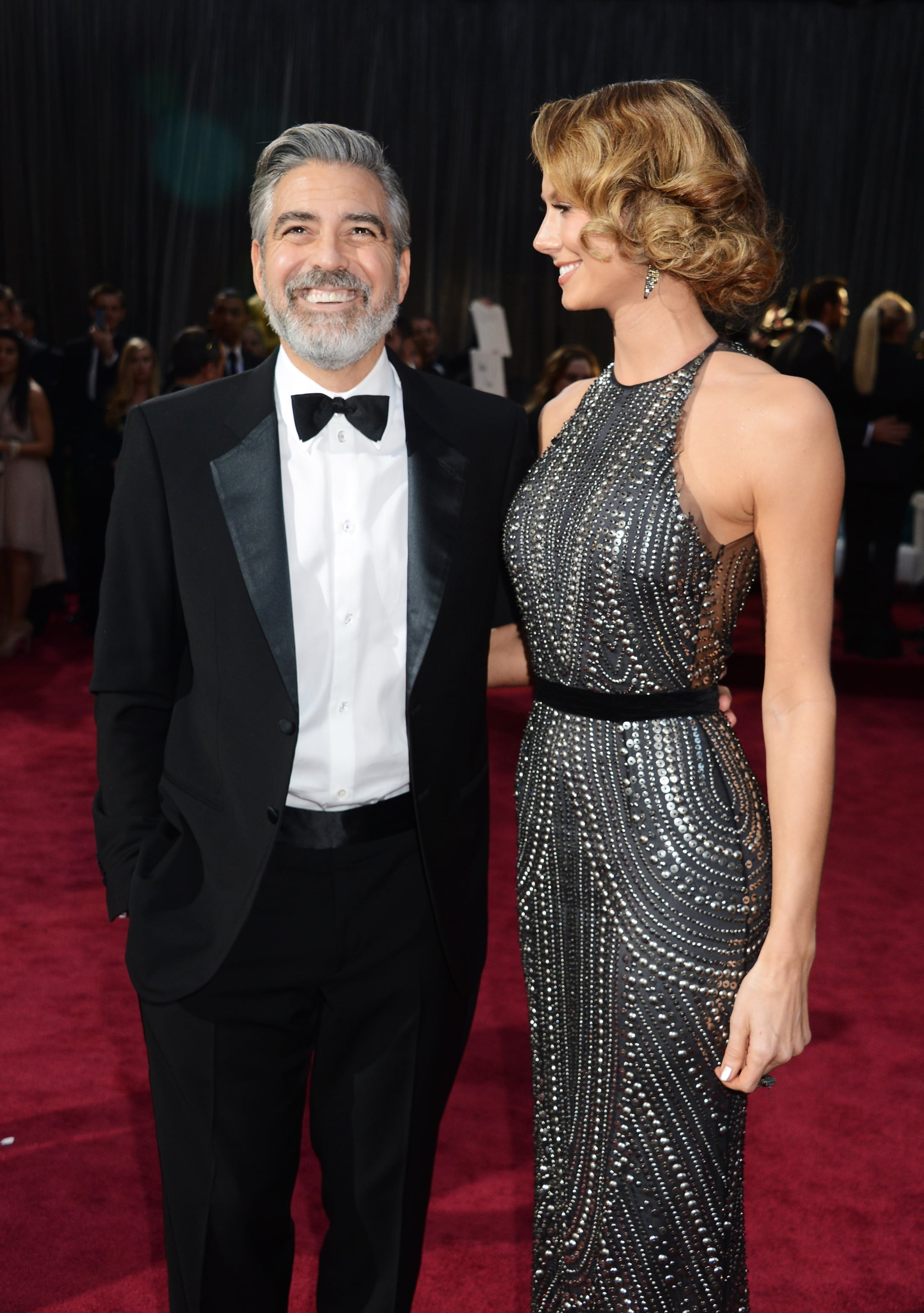 Stacy Keibler couldn't take her eyes off of George Clooney on the red carpet.