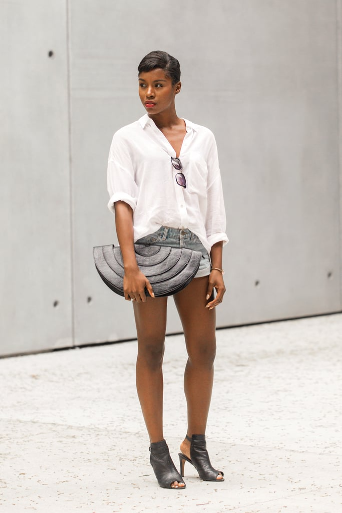 An oversized clutch can be the standout piece in a more neutral outfit.