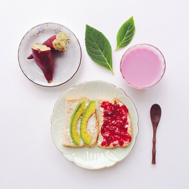 Here's a breakfast worthy of fueling a workout: cream cheese and avocado toast, raspberry jam toast, and a steamed sweet potato.