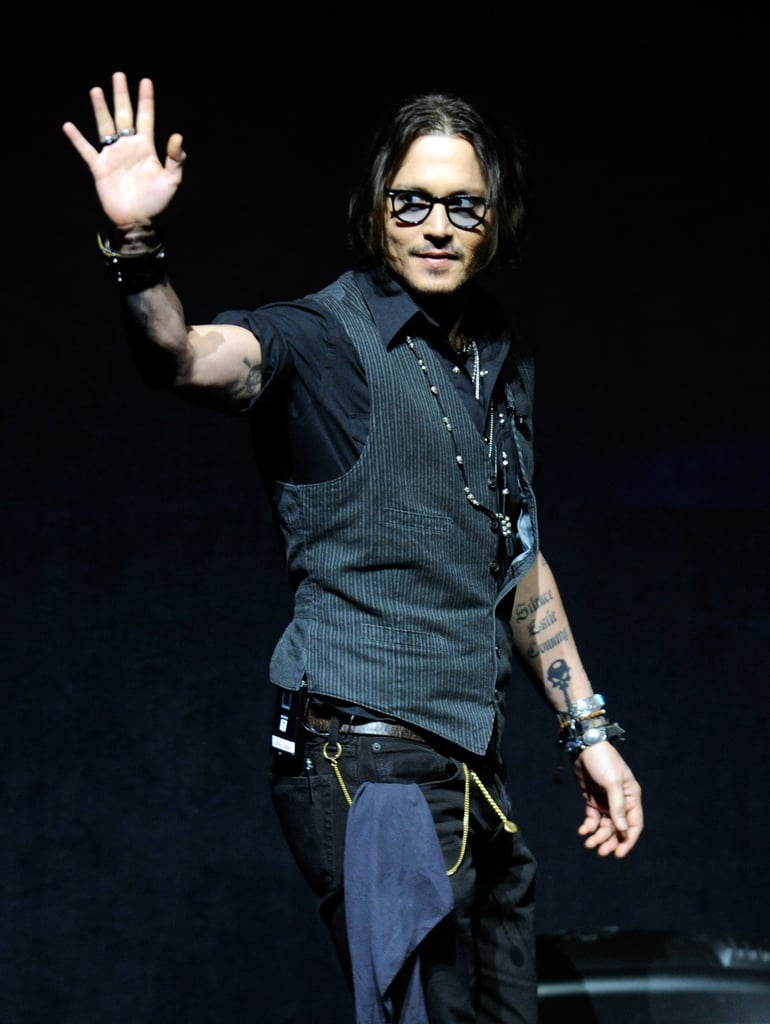 Johnny Depp waved at CinemaCon in Las Vegas.