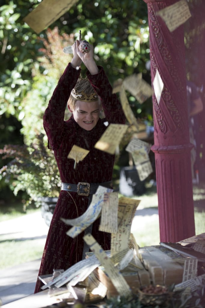 Joffrey rudely chops up Tyrion's wedding gift.
