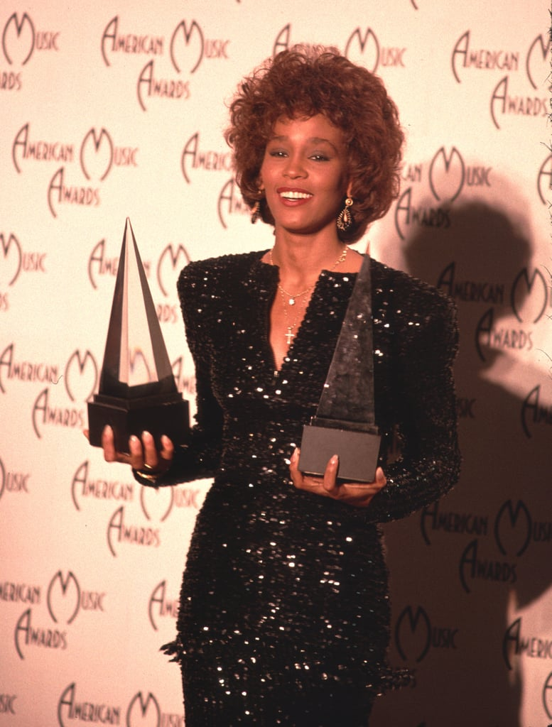 Whitney held onto her American Music Awards in 1989.