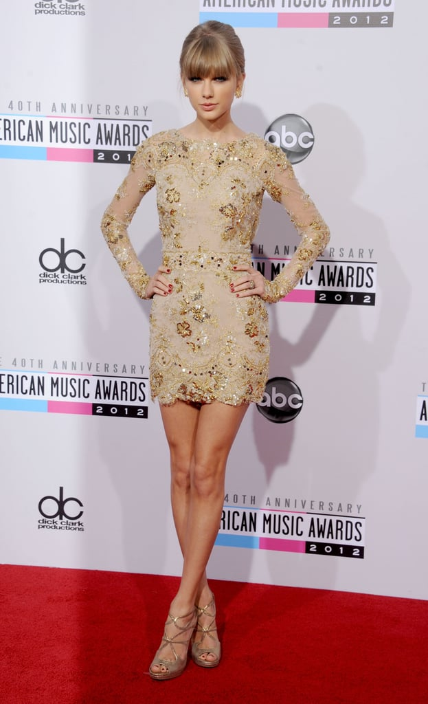 Taylor Swift stole the show at the American Music Awards this November, wearing a nude Zuhair Murad minidress and lace-up heels.