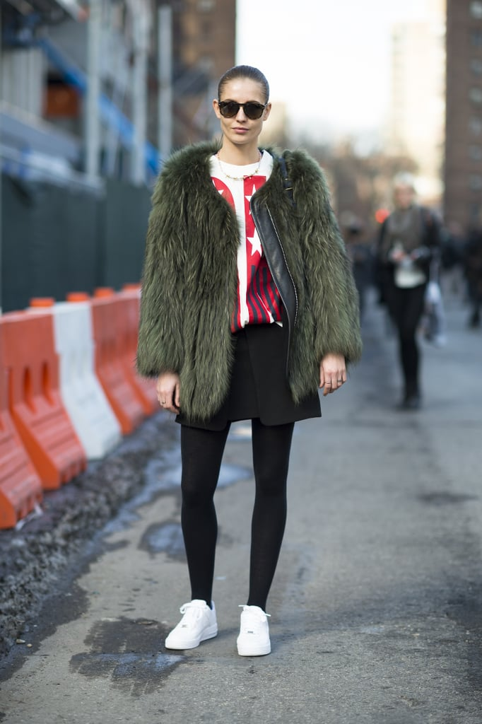 A statement-making fur is well-suited to practically any outfit — even an understated t-shirt and skirt. Source: Le 21ème   Adam Katz Sinding