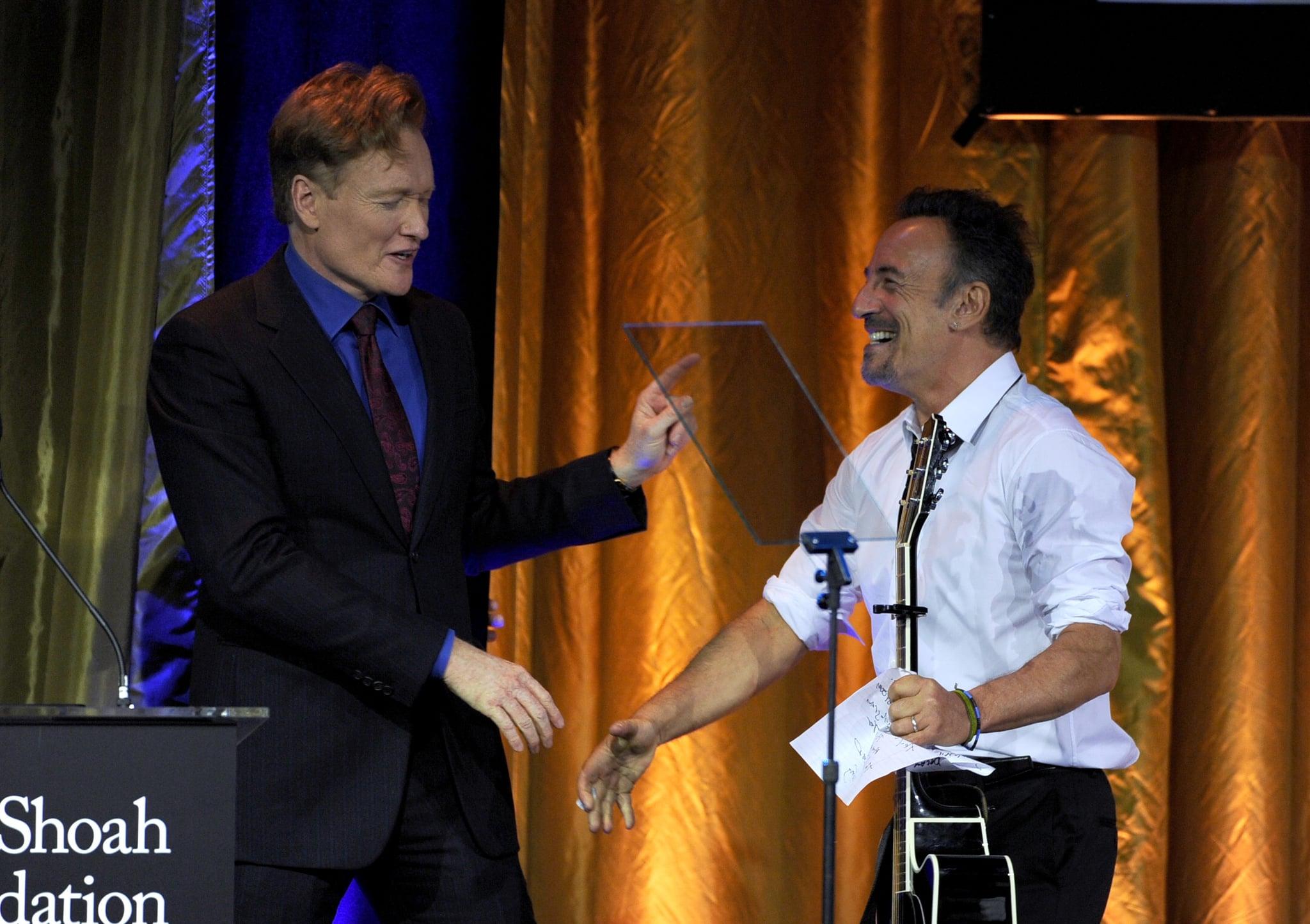 Conan O'Brien shook hands with Bruce Springsteen.